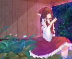 1girl absurdres bangs blurry blurry_foreground bow brown_eyes brown_hair building closed_mouth cup day depth_of_field detached_sleeves eyebrows_visible_through_hair falling_leaves feet_out_of_frame frilled_bow frilled_hair_tubes frilled_shirt_collar frilled_skirt frills hair_bow hair_tubes hakurei_reimu highres holding holding_cup house long_hair long_skirt long_sleeves muko_(kokia38) outdoors red_bow red_shirt red_skirt ribbon-trimmed_sleeves ribbon_trim shade shirt sidelocks sitting skirt smile solo sunlight tareme touhou two-handed wide_sleeves wooden_wall