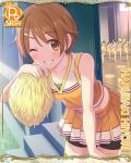 1girl book brown_eyes brown_hair card_(medium) cheerleader cygames extra hair_ornament hairclip harusaki_hiyori official_art one_eye_closed pom_poms princess_connect! shorts_under_skirt sweat