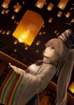 1girl bangs blurry brown_eyes brown_hair cowboy_shot depth_of_field dutch_angle from_side grey_hair hands_up hat high_collar highres japanese_clothes kariginu lantern light_smile long_sleeves looking_away luke_(kyeftss) mononobe_no_futo night open_hands open_mouth outdoors paper_lantern pom_pom_(clothes) ponytail profile railing ribbon-trimmed_sleeves ribbon_trim sideways_mouth sky_lantern solo standing tate_eboshi touhou wide_sleeves