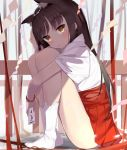 1girl absurdres animal_ears bangs bead_bracelet beads blurry blurry_background blush bracelet brown_eyes brown_hair closed_mouth commentary_request depth_of_field eyebrows_visible_through_hair hakama hakama_skirt head_tilt highres holding japanese_clothes jewelry kura_ekaki leg_hug long_hair looking_at_viewer miko no_shoes omikuji original red_hakama shide short_sleeves socks solo tabi thighs torn_clothes torn_socks very_long_hair white_legwear wide_sleeves