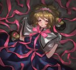 1girl alice_margatroid bangs blonde_hair blue_dress blue_eyes blush bow capelet dark doll dress eyebrows_visible_through_hair gloves hair_bow hairband highres long_hair lying masanaga_(tsukasa) on_back open_mouth pink_bow pink_neckwear puffy_sleeves ribbon sash shanghai_doll short_hair short_sleeves solo touhou violet_eyes white_gloves