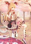 1girl absurdres bangs black_skirt blonde_hair boots collarbone day eating eyebrows_visible_through_hair flower full_body hair_between_eyes head_wings highres holding knee_boots layered_skirt long_hair looking_at_viewer outdoors red_eyes red_flower shadowverse shirt sitting skirt smile solo sugar_(dndi888) tree vampy very_long_hair white_flower white_footwear white_shirt