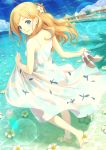 1girl bangs bare_legs bare_shoulders barefoot beach blonde_hair blue_eyes blue_sky clouds cloudy_sky commentary_request day dress eyebrows_visible_through_hair flower hair_flower hair_ornament high_heels highres holding long_hair looking_at_viewer looking_back ocean original outdoors shinonome_haru sky sleeveless sleeveless_dress smile solo standing sundress sunlight water white_dress