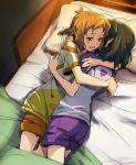 2girls bed black_hair blanket brown_eyes brown_hair hug kohinata_miku lying multiple_girls on_side pajamas pillow senki_zesshou_symphogear short_hair smile tachibana_hibiki_(symphogear) tsuta_no_ha yuri
