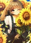 1girl ;) absurdres arm_up bangs blue_sky blurry blurry_foreground blush brown_eyes brown_hair closed_mouth clothes_writing clouds collarbone commentary_request day depth_of_field eyebrows_visible_through_hair field fingernails flower flower_field highres long_hair looking_at_viewer one_eye_closed original outdoors overalls rerrere shirt short_sleeves sky smile solo sunflower t-shirt white_shirt wide_sleeves yellow_flower