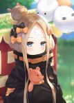 1girl abigail_williams_(fate/grand_order) balloon belt black_bow black_jacket blonde_hair blue_eyes blush bow closed_mouth fate/grand_order fate_(series) forehead hair_bow hair_bun highres hiyoko_(pixiv16803940) holding holding_stuffed_animal jacket long_hair looking_at_viewer medjed orange_bow sleeves_past_fingers sleeves_past_wrists solo stuffed_animal stuffed_toy teddy_bear