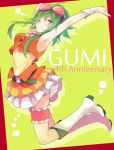 1girl ;d akiyoshi_(tama-pete) anniversary armpits arms_up bangs bare_arms bare_shoulders belt blush boots character_name fingernails frame frilled_skirt frills full_body goggles goggles_on_head green_background green_eyes green_hair green_nails grin gumi happy jumping leg_garter looking_at_viewer nail_polish number one_eye_closed open_mouth red_background shirt short_hair short_hair_with_long_locks simple_background skirt sleeveless sleeveless_shirt smile solo teeth thighs two-tone_background v vocaloid white_footwear wrist_cuffs