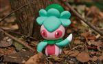 autumn_leaves creature fomantis full_body gen_5_pokemon morii_yuka nature no_humans official_art outdoors photo pink_eyes pokemon pokemon_(creature) pokemon_trading_card_game solo standing third-party_source