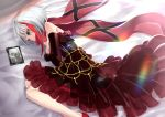1girl admiral_graf_spee_(azur_lane) azur_lane bangs bare_shoulders bed_sheet blue_eyes brown_flower brown_rose closed_mouth commentary_request deutschland_(azur_lane) dress elbow_gloves eyebrows_visible_through_hair feet_out_of_frame flower gloves layered_dress long_hair lying multicolored_hair on_side photo_(object) picture_frame pleated_dress purple_flower purple_rose red_dress red_flower red_footwear red_gloves red_rose red_scarf redhead revision rin2008 rose scarf see-through shoes silver_hair solo strapless strapless_dress streaked_hair