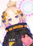 1girl abigail_williams_(fate/grand_order) alternate_hairstyle atsumi_jun bandaid_on_forehead bangs belt black_bow black_jacket blonde_hair blue_eyes blush bow fate/grand_order fate_(series) forehead hair_bow hair_bun heroic_spirit_traveling_outfit high_collar holding holding_stuffed_animal jacket long_hair looking_at_viewer orange_bow parted_bangs parted_lips polka_dot polka_dot_bow sleeves_past_fingers sleeves_past_wrists solo speech_bubble star stuffed_animal stuffed_toy teddy_bear