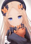 1girl abigail_williams_(fate/grand_order) absurdres bangs black_bow black_dress black_hat blue_eyes bow closed_mouth commentary_request coraman dress dutch_angle eyebrows_visible_through_hair fate/grand_order fate_(series) forehead gradient gradient_background grey_background hair_bow hat highres light_brown_hair long_hair long_sleeves object_hug orange_bow parted_bangs pixiv_fate/grand_order_contest_2 polka_dot polka_dot_bow sleeves_past_fingers sleeves_past_wrists smile solo stuffed_animal stuffed_toy teddy_bear very_long_hair
