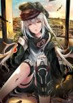 1girl bangs blue_sky blush brown_eyes bullet clouds coat day eyebrows_visible_through_hair floating_hair g11_(girls_frontline) girls_frontline green_coat grey_shirt hair_between_eyes half-closed_eyes hand_on_own_knee hand_up hat hirai_yuzuki indoors jacket knees_up long_hair looking_at_viewer off_shoulder open_clothes open_mouth red_scarf scarf scarf_on_head shirt shorts shoulder_cutout signature silver_hair single_knee_pag sitting sky sleeves_past_wrists solo sun sunset thigh_strap torn_clothes very_long_hair wind
