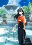 1girl bag_charm bayashiko black_hair black_skirt blue_sky bottle braid brown_eyes charm_(object) clouds commentary_request eyebrows_visible_through_hair glint highres holding long_hair long_skirt looking_at_viewer name_tag orange_shirt original outdoors path puffy_short_sleeves puffy_sleeves road rolling_suitcase shirt short_sleeves skirt sky smile solo standing tokyo_big_sight tree watch watch water_bottle