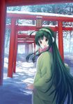 1girl blush brown_eyes day earmuffs eyebrows_visible_through_hair green_hair highres isou_nagi looking_at_viewer open_mouth outdoors real_world_location scarf scenery smile snow solo standing torii touhoku_zunko translation_request vocaloid voiceroid