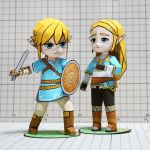 1boy 1girl aqua_eyes blonde_hair blue_eyes blue_shirt boots chibi full_body hair_ornament hairclip holding holding_sword holding_weapon link long_hair muumin_(muumin_craft) nintendo paper papercraft photo pointy_ears princess_zelda shield shirt short_hair sidelocks standing sword the_legend_of_zelda the_legend_of_zelda:_breath_of_the_wild weapon