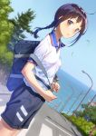 1girl ahoge artist_name bag black_shorts blue_sky blush braid breasts brown_eyes brown_hair collared_shirt commentary_request cowboy_shot crosswalk day duffel_bag dutch_angle from_side gym_uniform highres lamppost light_smile long_hair looking_at_viewer looking_to_the_side nose_blush ocean original outdoors pairan parted_lips road shiny shiny_hair shirt short_sleeves shorts sidelocks single_braid sky small_breasts solo street town tree