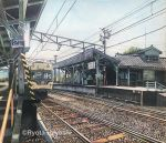 antennae artist_name colored_pencil_(medium) commentary ground_vehicle hayashi_ryouta no_humans original outdoors power_lines railing railroad_tracks real_world_location scenery sign sky stairs telephone_pole traditional_media train train_station train_station_platform tree