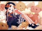 1girl abigail_williams_(fate/grand_order) bangs black_bow black_dress black_footwear black_hat blonde_hair blue_eyes blurry blurry_background bow dress fate/grand_order fate_(series) forehead hair_bow hat leaning_back legs long_hair looking_at_viewer omaru_gyuunyuu orange_bow parted_bangs parted_lips pillow polka_dot polka_dot_bow ribbed_dress sitting sleeves_past_fingers sleeves_past_wrists solo stuffed_animal stuffed_toy teddy_bear white_bloomers