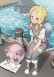 1girl bag blonde_hair closed_mouth creatures_(company) duffel_bag facepaint game_freak gazacy_(dai) gen_1_pokemon grey_eyes highres jigglypuff long_hair low_twintails matsurika_(pokemon) nintendo overalls paint pokemon pokemon_(creature) pokemon_(game) pokemon_lgpe shirt shoes short_sleeves sitting sketchbook smile twintails water white_shirt