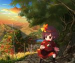 1girl black_legwear blue_sky city clouds commentary_request fence grass hair_ornament highres lake landscape leaf_hair_ornament long_sleeves mountain nature open_mouth orange_sky outdoors purple_hair red_shirt revision road rope shirt short_hair skirt sky solo standing tatuhiro touhou yasaka_kanako yellow_eyes younger