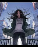 1girl bangs black_eyes black_hair blue_sky building city clothes_writing coat cowboy_shot day denim fence green_coat hands_in_pockets highres jeans letterboxed long_hair long_sleeves looking_at_viewer original outdoors pants parted_bangs parted_lips sky skyscraper smile solo standing sweater wind window1228