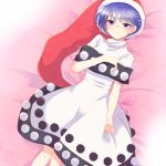 1girl aoi_(annbi) blue_hair commentary doremy_sweet dress hat highres lying nightcap on_back pom_pom_(clothes) red_hat solo touhou violet_eyes white_dress