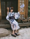 1girl doorway empty_room floral_print hair_between_eyes hands_up highres japanese_clothes leaf long_sleeves looking_to_the_side original outdoors patterned_clothing plant rock short_hair shrine sitting smile solo tifg39 translated tree wide_sleeves
