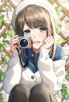 1girl :d bangs beret black_legwear blue_eyes blue_shirt blush brick_wall brown_hair camera collared_shirt commentary_request copyright_request dress_shirt eyebrows_visible_through_hair hands_up hat holding holding_camera jacket knees_up long_hair long_sleeves looking_at_viewer masuishi_kinoto off_shoulder official_art open_mouth pantyhose shirt sitting sleeves_past_wrists smile solo white_headwear white_jacket