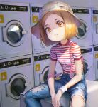 1girl absurdres alternate_costume american_flag bangs blonde_hair denim fate/grand_order fate_(series) hat highres huge_filesize indoors jeans laundromat overalls pants parted_bangs paul_bunyan_(fate/grand_order) ripped_jeans shirt shogo_(shogo) short_hair short_sleeves sitting smiley_face solo striped striped_shirt torn_clothes torn_jeans torn_pants washing_machine white_hat wristband yellow_eyes