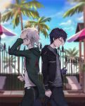 2boys back-to-back black_jacket black_legwear blue_sky blurry blurry_background chains clenched_hand closed_mouth clouds commentary_request covering_one_eye danganronpa day fence from_side green_jacket grey_shirt grin hand_in_hair hand_over_eye highres holding jacket kaer_sasi_dianxia komaeda_nagito looking_down male_focus medium_hair multicolored_hair multiple_boys open_clothes open_jacket original outdoors palm_tree pants shirt sky smile sunlight super_danganronpa_2 teeth tree white_hair white_shirt