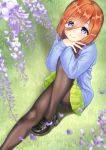 1girl ass bangs black_footwear blue_eyes blue_sweater blurry blush brown_legwear closed_mouth commentary_request depth_of_field eyebrows_visible_through_hair fine_fabric_emphasis flower flower_request from_above go-toubun_no_hanayome grass green_skirt hair_between_eyes highres knee_up loafers long_hair long_sleeves looking_at_viewer mimikaki_(men_bow) miniskirt nakano_miku orange_hair pantyhose petals pleated_skirt purple_flower shadow shoes skirt sleeves_past_wrists smile solo sweater thighband_pantyhose