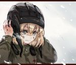 bangs black_hat blizzard blonde_hair blue_eyes closed_mouth commentary dirty_face eyebrows_visible_through_hair frown girls_und_panzer green_jumpsuit hands_on_headwear hat katyusha letterboxed long_sleeves pravda_military_uniform short_hair sketch snow tank_helmet tearing_up upper_body yuuyu_(777)
