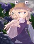 1girl :o arm_up bangs blonde_hair blue_eyes blue_skirt blue_vest blurry cacao_devil commentary_request day depth_of_field flower foreshortening hat high_collar highres hydrangea long_sleeves looking_at_viewer moriya_suwako outdoors overcast reaching_out shirt short_hair sidelocks skirt solo touhou upper_body vest water_drop white_shirt