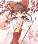 1girl absurdres ascot autumn_leaves bangs bare_shoulders bow brown_eyes brown_hair commentary_request cowboy_shot detached_sleeves dress eyebrows_visible_through_hair frilled_bow frilled_shirt_collar frills gohei hair_between_eyes hair_bow hair_tubes hakurei_reimu highres holding kizitora_hato long_hair long_sleeves looking_at_viewer ofuda open_mouth red_bow red_dress ribbon-trimmed_sleeves ribbon_trim sarashi shide sidelocks simple_background solo touhou white_background wide_sleeves yellow_neckwear