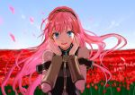 1girl absurdres arms_up blue_eyes blue_sky blurry bob_(biyonbiyon) commentary depth_of_field detached_sleeves field flower flower_field hairband headphones highres long_hair looking_at_viewer megurine_luka open_mouth petals pink_hair sky solo very_long_hair vocaloid