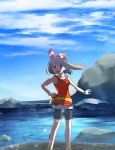 1girl bike_shorts black_shorts blue_sky bow brown_hair clouds creatures_(company) day floating_hair game_freak hair_bow hairband haruka_(pokemon) highres holding holding_poke_ball long_hair nintendo outdoors outstretched_arm poke_ball pokemon pokemon_(game) pokemon_oras red_hairband shirt short_shorts shorts shorts_under_shorts sky sleeveless sleeveless_shirt solo standing striped striped_bow white_shirt white_shorts wristband yuihiko