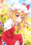 1girl :p arms_behind_back bending_forward blonde_hair blue_sky blurry blush clouds commentary_request cravat crystal day depth_of_field eyebrows_visible_through_hair flandre_scarlet garden hair_between_eyes hat hat_ribbon highres looking_at_viewer miy@ mob_cap outdoors petals puffy_short_sleeves puffy_sleeves red_eyes red_skirt red_vest ribbon shirt short_hair short_sleeves side_ponytail skirt sky solo standing tongue tongue_out touhou vest white_shirt wind wings yellow_neckwear