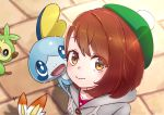 1girl absurdres bangs blue_eyes blush brown_eyes brown_hair cardigan closed_mouth commentary_request creatures_(company) eyebrows eyebrows_visible_through_hair eyes_visible_through_hair female_protagonist_(pokemon_swsh) game_freak gen_8_pokemon green_hat grookey hair_between_eyes hat highres koka12312 looking_at_viewer nintendo open_mouth outdoors pokemon pokemon_(creature) pokemon_(game) pokemon_swsh scorbunny shirt short_hair smile sobble standing tam_o'_shanter