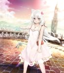 1girl absurdres animal_ears azur_lane bag bell blue_eyes blurry blush bow breasts brick_road cat_ears cat_tail city cityscape cleavage clenched_hand clouds collarbone commentary_request depth_of_field dress eyebrows_visible_through_hair eyelashes fang flower furrowed_eyebrows hair_between_eyes hair_bow hair_flower hair_ornament hammann_(azur_lane) handbag highres jewelry long_hair looking_at_viewer medium_breasts necklace open_mouth pendant pointing railing river rurekuchie sky solo spaghetti_strap sunset tail tail_bell tail_ornament tears tower tsurime very_long_hair white_hair wind