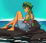 1girl barefoot commission creatures_(company) dark_skin flower from_behind full_body game_freak green_eyes green_hair hair_flower hair_ornament headband highres light_smile lips long_hair looking_back low_twintails lying mao_(pokemon) nintendo ocean overall_shorts pokemon pokemon_(anime) pokemon_(game) pokemon_sm pokemon_sm_(anime) polyle pose rock solo strapless trial_captain tubetop twintails