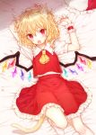 1girl :o animal_ear_fluff animal_ears arms_up ascot bangs bed_sheet blonde_hair blush cat_ears cat_tail commentary_request crystal eyebrows_visible_through_hair feet_out_of_frame flandre_scarlet frilled_shirt_collar frills from_above hair_between_eyes hat hat_removed hat_ribbon headwear_removed honotai kemonomimi_mode looking_at_viewer lying mob_cap on_back open_mouth petticoat puffy_short_sleeves puffy_sleeves red_eyes red_ribbon red_skirt red_vest ribbon shirt short_hair short_sleeves skirt socks solo tail touhou vest white_headwear white_legwear white_shirt wings wrist_cuffs yellow_neckwear