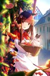 1girl alphatitus animal_ears apple apron bangs basket bell blurry blurry_background brown_hair capelet cat cat_ears cityscape commentary_request eyebrows_visible_through_hair flower food fruit hair_ornament hair_ribbon highres holding holding_basket long_hair looking_at_viewer open_mouth original paw_ornament red_capelet red_eyes red_ribbon ribbon