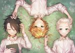 1girl 2boys ahoge black_hair blonde_hair blue_eyes blush book closed_eyes collared_shirt dress_shirt emma_(yakusoku_no_neverland) from_above green_eyes hand_in_another's_hair highres long_sleeves lying multiple_boys norman_(yakusoku_no_neverland) notsuki_(koma128) number on_back ray_(yakusoku_no_neverland) shirt short_hair silver_hair smile sweatdrop tattoo white_shirt wing_collar yakusoku_no_neverland