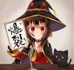1girl black_cat blush brown_hair calligraphy cape cat chomusuke collar fingerless_gloves gloves hat highres holding ink_on_face kono_subarashii_sekai_ni_shukufuku_wo! looking_at_viewer megumin microphone red_eyes reiwa short_hair_with_long_locks translated witch_hat yuno_(suke_yuno)