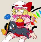 1girl animalization ascot black_headwear blonde_hair blue_eyes cat fang fingernails flandre_scarlet frown furukawa_(yomawari) hat hat_ribbon highres komeiji_koishi komeiji_koishi_(cat) long_fingernails long_hair looking_at_another looking_down mob_cap nail_polish on_lap one_eye_closed open_mouth puffy_short_sleeves puffy_sleeves red_eyes red_nails red_ribbon ribbon short_sleeves sitting tail tan_background thigh-highs third_eye touhou whiskers white_headwear white_legwear wings yellow_ribbon