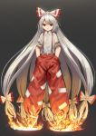 1girl dark_background fire fujiwara_no_mokou full_body grey_hair hair_ribbon hands_in_pockets highres long_hair looking_at_viewer ponytail red_eyes ribbon smile solo suna_(s73d) suspenders torn_clothes torn_sleeves touhou very_long_hair white_hair