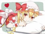 1girl blonde_hair blush clenched_hand eyebrows_visible_through_hair fang fang_out flandre_scarlet grey_background hair_between_eyes hat hat_ribbon head_on_pillow heart highres iyo_(ya_na_kanji) looking_at_viewer lying mob_cap on_stomach pillow pointy_ears red_eyes red_skirt red_vest ribbon shirt short_hair side_ponytail simple_background skirt slit_pupils smile solo touhou vest white_headwear white_shirt wrist_cuffs