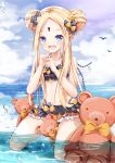 1girl :d abigail_williams_(fate/grand_order) bangs bare_arms bare_shoulders bikini black_bikini black_bow blonde_hair blue_eyes blue_sky blush bow clouds cloudy_sky collarbone commentary_request day double_bun emerald_float eyebrows_visible_through_hair fang fate/grand_order fate_(series) forehead full_body hair_bow hands_up highres holding holding_key horizon key keyhole kneeling long_hair looking_at_viewer mutang ocean open_mouth orange_bow outdoors parted_bangs polka_dot polka_dot_bow sidelocks sky smile solo stuffed_animal stuffed_toy swimsuit teddy_bear very_long_hair water