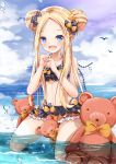 1girl :d abigail_williams_(fate/grand_order) bangs bare_arms bare_shoulders bikini black_bikini black_bow blonde_hair blue_eyes blue_sky blush bow clouds cloudy_sky collarbone day double_bun emerald_float eyebrows_visible_through_hair fang fate/grand_order fate_(series) forehead full_body hair_bow hands_up highres holding holding_key horizon key kneeling long_hair looking_at_viewer mutang ocean open_mouth orange_bow outdoors parted_bangs polka_dot polka_dot_bow sidelocks sky smile solo stuffed_animal stuffed_toy swimsuit teddy_bear very_long_hair water