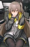 1girl armband between_legs black_jacket black_legwear blush brown_eyes brown_hair commentary_request eyebrows_visible_through_hair fingerless_gloves girls_frontline gloves hair_between_eyes hand_between_legs jacket long_hair long_sleeves looking_at_viewer one_side_up pantyhose scar scar_across_eye sitting solo tobimura ump45_(girls_frontline)